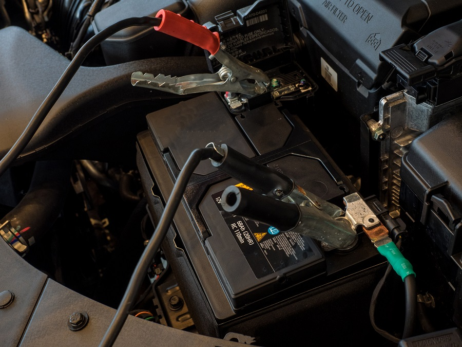 Jumping a car battery with jumper cables