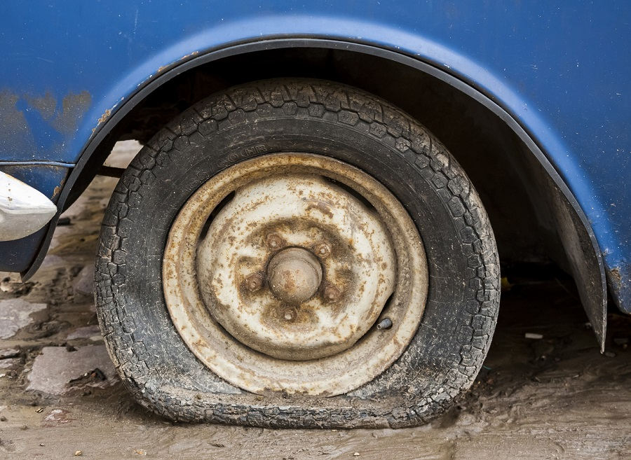 old car tire dry rot cracked and rotten